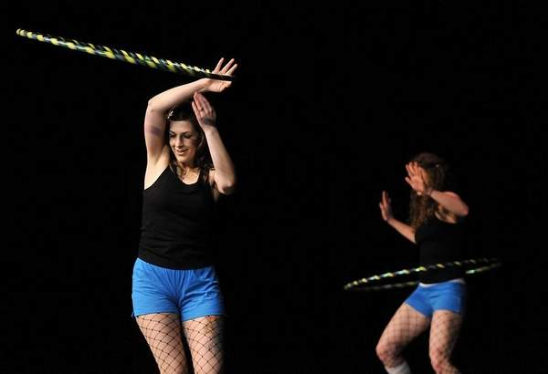 Twistin Vixens hoop dance on stage at talent show