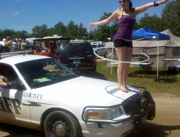 Moondance Jam Hula Hooper on a Police Car