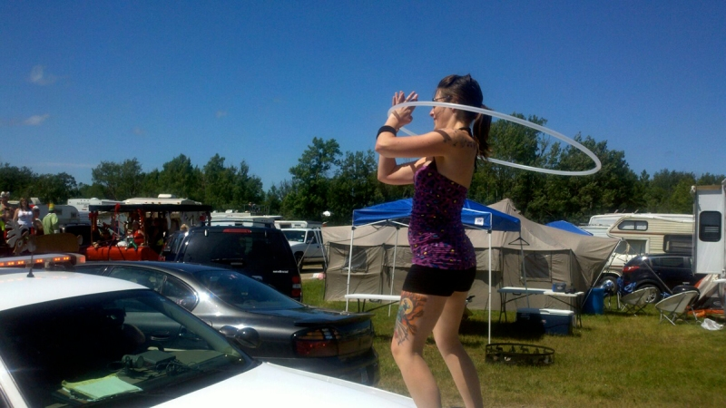 Hula Hooper at Moondance Jam on Police Car