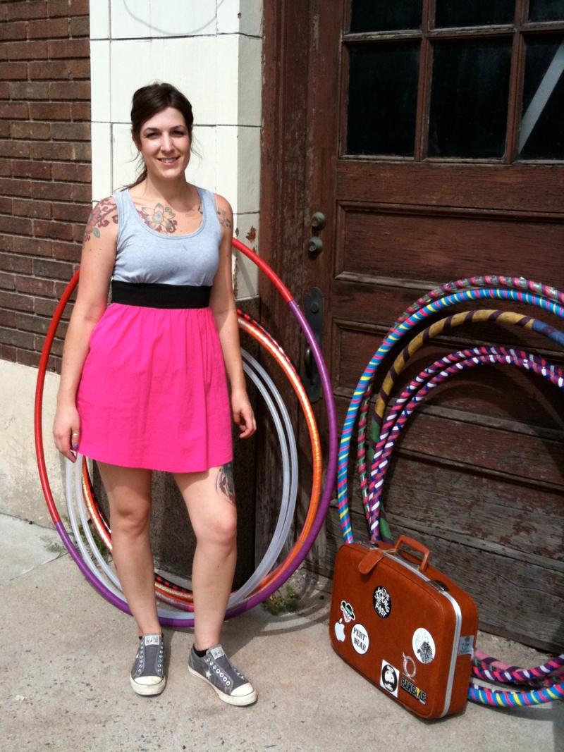 Hula hooper posing with hoops