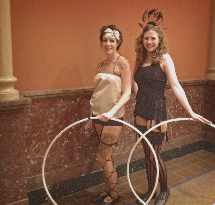 Hula hoopers in vintage circus costumes
