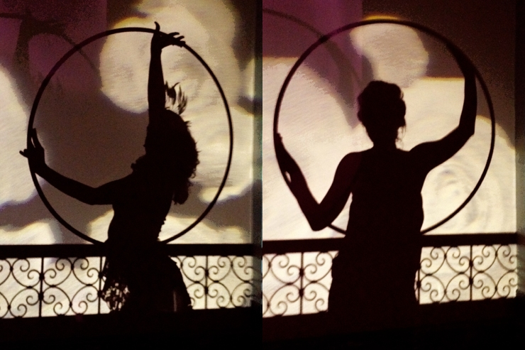Silhouettes of hula hoopers in costume