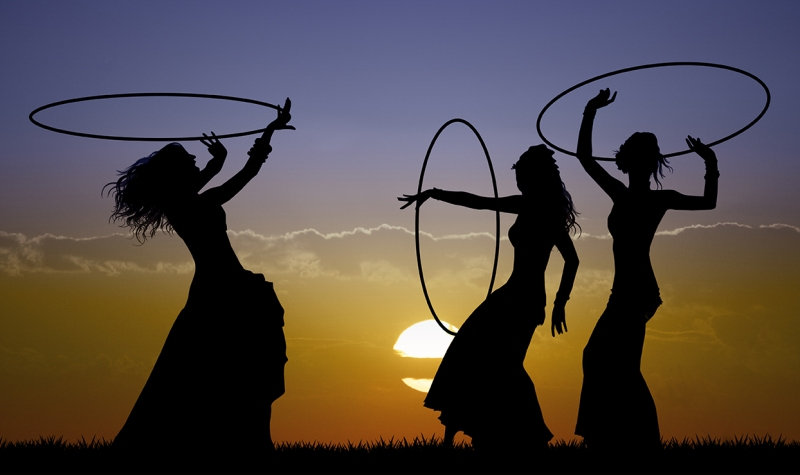 Hawaiian hoop dancers sunset